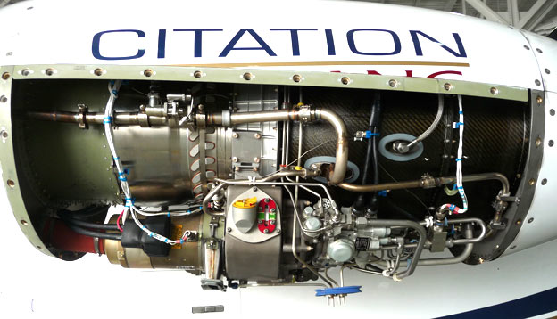 Citation Mustang left engine with cowl off photo