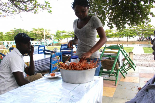 Lobster and fish dinner on the beach in Les Cayes