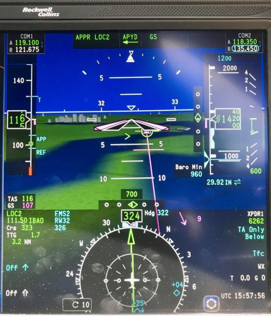PFD with Synthetic Vision view on ILS for KMSN. Note the detail of the buildings and rivers.
