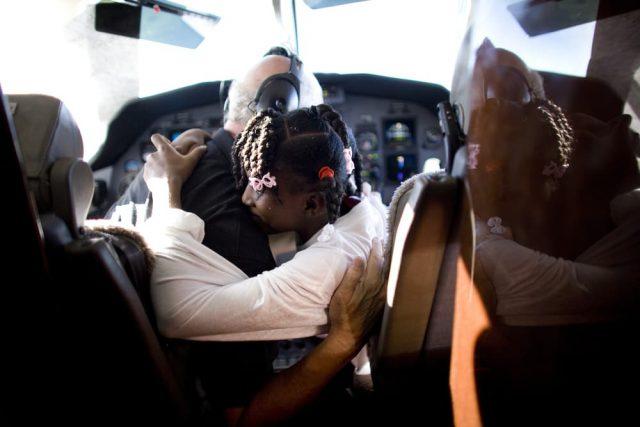 rich daphka haiti hug